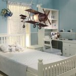 airplane-shape pendant light in wood material casual white desk and chair white shelves and cabinet system white-tone bed furniture white-printed window curtain blue wallpaper for wall system