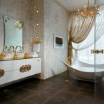 aluuring bathroom ideas with gorgeous golden tone also unique bathtub design with elegant vanities and wonderful mirror in granite tile flooring