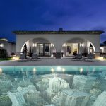 Amazing Swimming Pool With City View Decorative Tiles Grey Pave Outdoor Flooring Grey Wall White Sconces Grey Deck Chairs Black Framed Window White Curtains