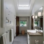 astonishing white bathoom with elegant marble top cabinet and large mirror with cute towel rack in granite tile flooring