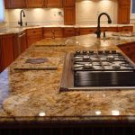beautiful-lines-granit countertop planted stove and grill black-tone faucet wood cabinetry for kitchen set