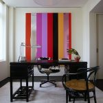 beautiful working space concept with assorted color stripes wall also gorgeous glossy black table with rattan chairs and unqie silvery desk lamp