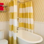 beautiful  yellow-white tub curtain porcelain small and deep bathtub stainless steel towel bar modern toilet unit yellow pattern walls small-pattern tiles flooring