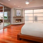 bedroom with fireplace addition feat interesting sliding glass door also frosted glass window with simple low proile bed in laminate flooring idea