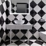 black and white ceramic tiled wall and floor white framed square mirror white round vessel sink white smple bathroom counter modern black and white bathroom hotel design The Club Hotel in Singapore