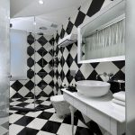 black and white ceramic tiled wall and floor white simple counter white round vessel sink white painted ceiling cornered shower black and white bathroom design The Club Hotel in Singapore