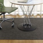 black carpet with basket weave patterns movable chair with green color white top round desk with tiny metal legs