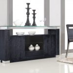 black sideboard with open -door shelves and transparent glass top decorative wareplates glass decorative  wine glasses white vases with patterns smooth and soft fury carpet black wood dining chairs