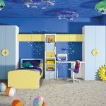 blue painted wall sand patterned flooring yellow bedframe light blue storage white study table blue ceiling with water ripple patterned hanged float cute underwater themed kids' room