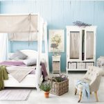 blue wall white wood canopy frame white carpet flooring white wardrobe white side table beige canopy covers white rug wood table lamp with blue cover white chair huge white chinese porcelain purple blanket