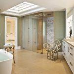 captivating bathriim concept with elegant dark gray walling and ravishing wooden vanities with rattan cahir in granite tile flooring