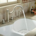 cast iron kitchen sink double sprayer control and faucet natural stone kitchen countertop