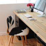 classic working space area with unique animal print chairs also ravishing wooden desk with cute rattan basket in hardwooden flooring