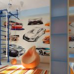 colorful bright striped rug car themed wallpaper orange beanbag chair white ceiling blue ladder with white rope cream tiled flooring  car themed bedroom pale blue chandelier