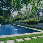 concrete rectangular steps rectangular pool concrete pool border cute some small fountains amazing green scenery grass outdoor ground white fence