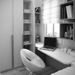 corner deks home office with high shelving units a portable PC device a pile of books white storage boxes