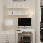 corner monitor deks with cabinets in white color  pure white table lamp mini top cabinet arrangements  cute and colorful painting with white tiny frame computer set small movable chair