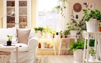 creame painted wall wooden floor white painted coffee table white sofa white painted storage steeled standing lamp green houseplants white painted wooden pot how to make spring smell home