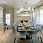 Cute Dining Room Design With Soft Blue Chairs Also Glossy Wooden Dining Table And Wonderful Chandelier With Attractive Creamy Wall Color Also Large Turkey Rectabgular Rug In Laminate Flooring