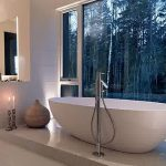 Elegant Bathroom Design With Bowl Bathtub Also Elegant Large Glass Window Overlaooking Nature View Feat Elegant White Accnet In Glossy Tile Flooring