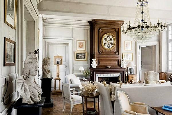 elegant french interior style with wonderfyl distressed furniture and  luxurious chandelier with cozy white couch in