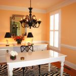elegant home office design with gorgeous white glossy wooden table also cute orange backdrop with beautiful black chandelier and zebra motif rug with classic wall mount mirror