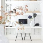 elegant white office home with wonderful wooden wall and interesting potted flower with ethnic rug