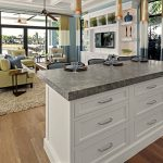 expensive grey granite countertop with white wood cabinet system hardwood floor with clear natural lines