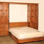 folding bed with double cupboards plus cabinetry in rustic