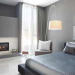futuristic bedroom idea with silvery bedsheet also ravishing small wall mount firelace with grey curtain in white laminate flooring