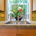 glass panels garden window behind the backsplash beautiful flower ormament