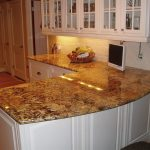glossy  granite countertop with L letter shape a high-tech monitor crafted-rattan fruits basket top glass door cabinetry