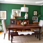 gorgeous dining room design with classic hardwooden table also ravishing dark green wall decoration feat ethnic wall decoration with white ceiling in large rug idea