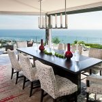 gorgoeus dining room idea overlooking sea view feat ravishing white fabric chairs and glossy black long table in granite tile flooring