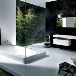 green bathroom idea with ravishing black tile walling also giant white bathtub with amazing floating sink and elegant transparent glass window in white concrete flooring