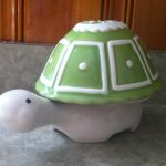 green turtle shell cup with white turtle base
