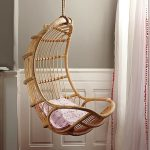 hanging chair in rattan material sweet pink decorative pillow
