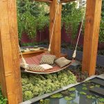 hanging daybed made from lightweight plaque wood ethnic patterns pillowa mini pond
