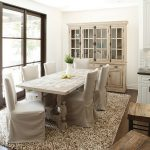 hardwooden table for dining with elegant white chairs and rustic cabinet also warm fur rug with frosted glass design in hardwooden flooring idea