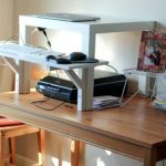home-made standing desk  in white color netbook with scanner a picture frame wood finishing table
