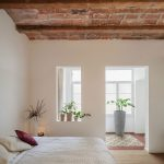 interesting bedroom idea of 19th century with elegant white wall design also elegant bedding concept with potted plant in laminate flooring and rustic ceiling