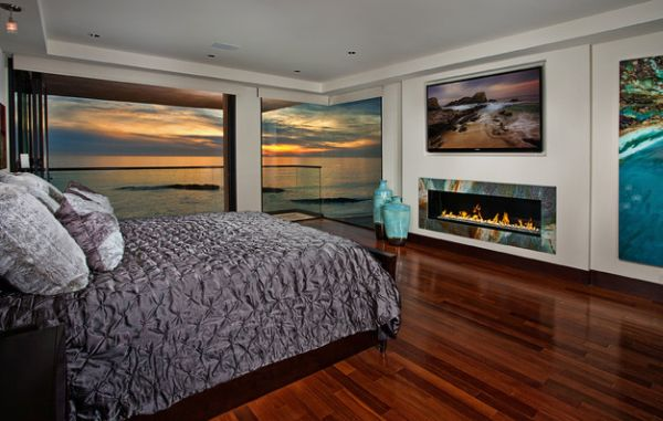 interesting bedroom idea with wonderful fireplace also gorogeus beach view  outside and futuristic silver bedsheet in. Bedroom Fireplace Design Ideas That Will Keep Your Love In The Air