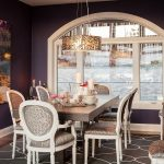 interesting dining room design with dark purple wall color decoration also elegant brown wooden dining sets with unique scone with abstract painting in hardwooden flooring