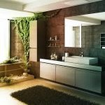 Interesting Green Bathroom Idea With Floating Silvery Vanities Also Large Wallmount Mirror With Elegant Black Rug Completed With Green Vegetation In Granite Tile Flooring