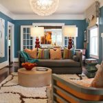 interesting living room idea with upholstered couch also amazing fabric rugs and luxurious chandelier with elegant blue walling and giant desk lamp in laminate flooring