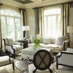 interesting living room idea with zebra motif rug also elegant white sofa and animal print cushion with wide stripe curtains in large carpeting concept