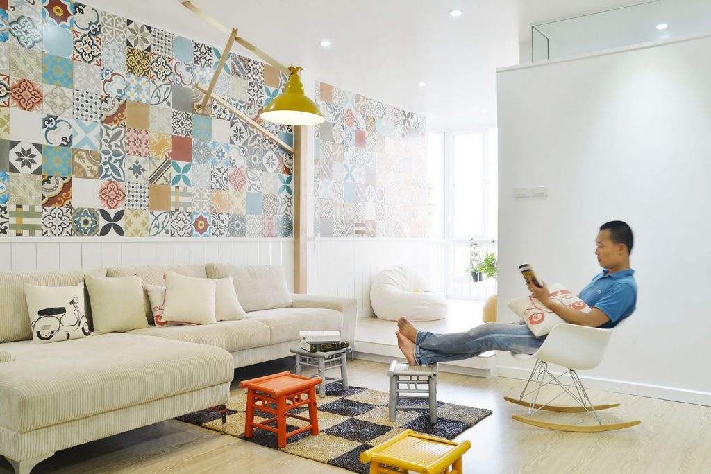 interesting reading area feat soft cotton couch also energizing white wall accent and alluring assorted color mosaic walling with interesting wall lamp in square pattern rug