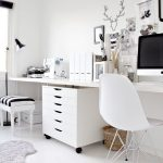 interesting white office with whimsical wall decoration and simple drawers with elegant rug in laminate flooring
