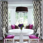 large bay window with floor-to-ceiling beautiful white-black curtains artistic pendant lamp with black cover a comfortable living room furniture with sweet purple and white  accent  diamond-cut prints carpet