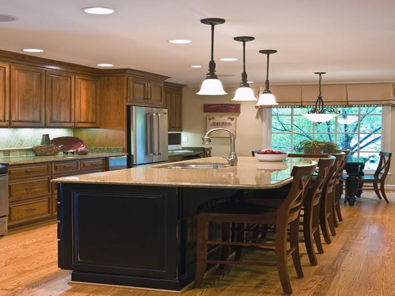 Large Kitchen Islands With Granite Top large granite top kitchen island arrangement of dining chairs three classic  pendant lamps round ceiling lamps